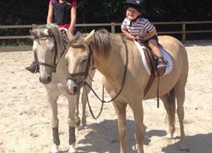 Our youngest two on there ponies.